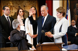 Secretary Cascos is sworn in as Texas Secretary of State by Governor Greg Abbot with family watching.
