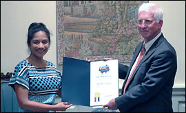 Secretary Nandita Berry presents Blue Bell CEO, President Paul Kruse, with a proclamation celebrating the company's 107 years.