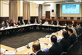 Secretary Pablos is seated along with other committee members at a a large desk. Name plaques are displayed in front of each individual.