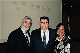 Secretary Pablos posing with Israeli Consul General Eitan levon and ABC 13's Melanie Lawson.